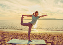 Young woman practicing yoga on beach Royalty Free Stock Photography