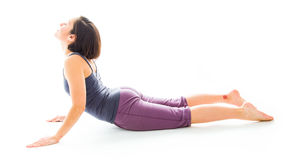 Young woman practicing yoga in cobra pose Royalty Free Stock Photo