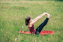 Young woman practicing yoga, Does morning exercises, royalty free stock image