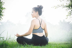 Young woman practicing yoga Everyday Yoga helps in concentration. Breath, shape body, strength, help skin brighten. Among the Dharma Air in bright days Royalty Free Stock Photography
