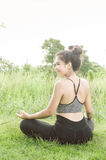 Young woman practicing yoga Everyday Yoga helps in concentration. Breath, shape body, strength, help skin brighten. Among the Dharma Air in bright days Stock Photo