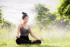 Young woman practicing yoga Everyday Yoga helps in concentration. Breath, shape body, strength, help skin brighten. Among the Dharma Air in bright days Royalty Free Stock Photo