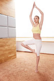 Young Woman is Practicing Yoga at Home.  Stock Photos