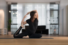 Young woman practicing yoga Stock Photo