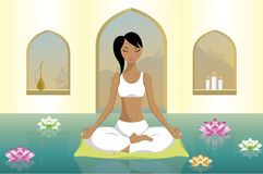 Young woman practicing yoga royalty free stock images