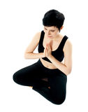 Young woman practicing yoga in the lotus position royalty free stock image