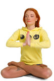 Young woman practicing yoga in the lotus position Stock Photo