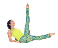 Young woman practicing yoga, lying on back with feet up variatio Royalty Free Stock Images