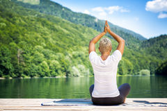 Young woman practicing yoga meditation Stock Photography