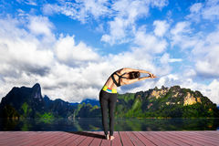 Young woman is practicing yoga Royalty Free Stock Image