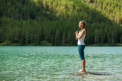 Young woman is practicing yoga Stock Image