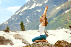 Young woman is practicing yoga Royalty Free Stock Images