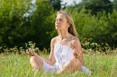 Young woman practicing yoga in nature Royalty Free Stock Image