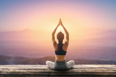 Young woman practicing yoga in the nature, Female happiness, Young woman is practicing yoga at mountain royalty free stock photography