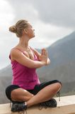 Young woman practicing yoga on the nature Stock Photos