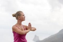 Young woman practicing yoga on the nature Stock Photo