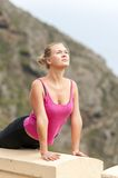 Young woman practicing yoga on the nature Stock Image