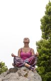Young woman practicing yoga on the nature Royalty Free Stock Image