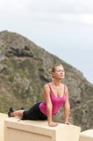 Young woman practicing yoga on the nature Royalty Free Stock Photography