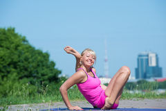 Young woman practicing yoga in nature Royalty Free Stock Photos
