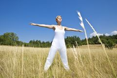 Young woman practicing yoga outdoor Royalty Free Stock Photo