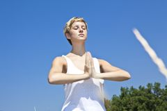 Young woman practicing yoga outdoor Stock Photography