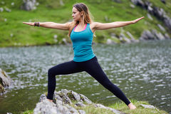 Young woman practicing yoga outdoor Stock Image