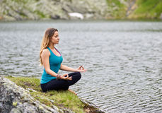 Young woman practicing yoga outdoor Royalty Free Stock Image