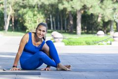 Young woman practicing yoga outdoor in park royalty free stock image