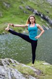 Young woman practicing yoga outdoor Stock Photo