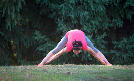 Young woman practicing yoga outdoors Stock Image