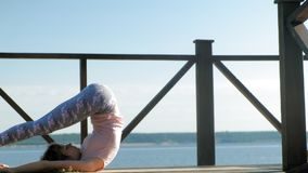 Young woman practicing yoga outdoors in summer. Healthy lifestyle stock video