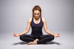 Young woman practicing yoga perfect or lotus pose Stock Photography