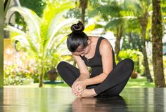Young woman is practicing yoga and pilates on nature. Royalty Free Stock Image