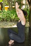 Young woman is practicing yoga and pilates on nature. Royalty Free Stock Images