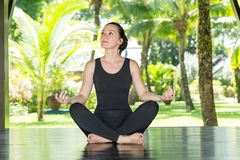 Young woman is practicing yoga and pilates on nature. royalty free stock photos