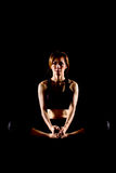 Young woman practicing yoga. Portrait of pretty young woman doing yoga exercise Stock Images