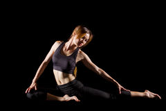 Young woman practicing yoga. Portrait of pretty young woman doing yoga exercise Royalty Free Stock Photo