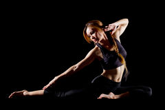 Young woman practicing yoga. Portrait of pretty young woman doing yoga exercise Royalty Free Stock Photos