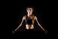 Young woman practicing yoga. Royalty Free Stock Images
