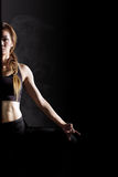 Young woman practicing yoga. Portrait of pretty young woman doing yoga exercise Royalty Free Stock Photography