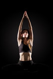 Young woman practicing yoga. Stock Photo