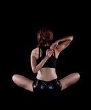 Young woman practicing yoga. Portrait of pretty young woman doing yoga exercise Royalty Free Stock Images