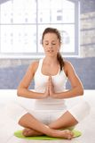 Young woman practicing yoga prayer pose Royalty Free Stock Photography