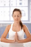 Young woman practicing yoga prayer pose Stock Image
