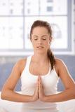 Young woman practicing yoga prayer pose Stock Image