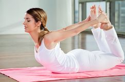 Young Woman Practicing Yoga Stock Photos
