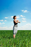 Young woman practicing yoga and relaxing at summer Royalty Free Stock Photo