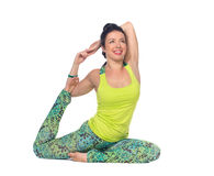 Young woman practicing yoga, sitting in a cobra position, isolat Stock Image