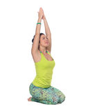 Young woman practicing yoga, sitting in a lotus position, isolat Stock Images